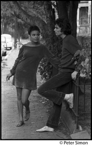 Thumbnail of Donna Carson and Hedge Capers (of Hedge and Donna) on the street