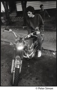 Thumbnail of Hedge Capers (of Hedge and Donna): standing by a motorcycle