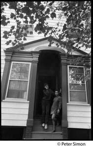 Thumbnail of Hedge Capers and Donna Carson (of Hedge and Donna), standing at the entrance to             a house