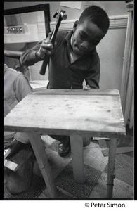 Thumbnail of Boy hammering a nail into wood, Liberation School, Boston, Mass.
