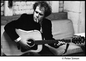 Thumbnail of Tim Hardin smoking a cigarette and playing guitar at the Unicorn Coffee House, Boston, Mass.