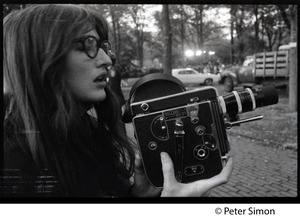 Thumbnail of Woman filming with a 16mm Bolex camera at the George Wallace rally on Boston Common
