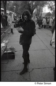 Thumbnail of Woman with a 16mm Bolex camera, covering the George Wallace rally on Boston Common