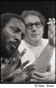 Thumbnail of Presidential candidate Dick Gregory on stage with interviewer Jerome Lettvin on             Channel 56 (Lettvin in the background)