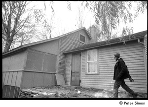 Thumbnail of Raymond Mungo walking past the house, Packer Corners Commune
