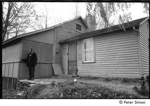 Thumbnail of Raymond Mungo standing outside the house, Packer Corners Commune