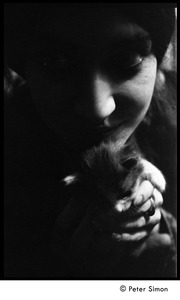Thumbnail of Portrait of a young woman with a kitten (close-up)