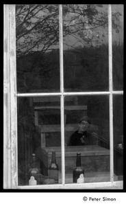 Thumbnail of Raymond Mungo reflected in a barn window: Packer Corners commune