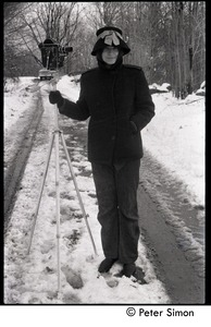 Thumbnail of Unidentified woman in the snow with 16mm motion picture camera