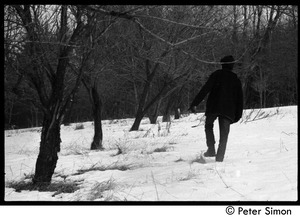 Thumbnail of Raymond Mungo trudging through the snow, Packer Corners commune