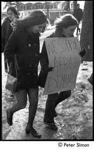 Thumbnail of Women walking to protest, carrying sign: 'We support Afro's demands': white student support for Brandeis             University African American student protest