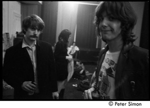 Thumbnail of The Byrds and Flying Burrito Brothers performing at the Boston Tea Party: Roger             McGuinn an Gram Parsons (l. to r.) behind stage