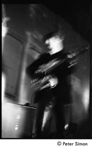 Thumbnail of The Byrds and Flying Burrito Brothers performing at the Boston Tea Party: Roger             McGuinn playing guitar (partial double exposure)