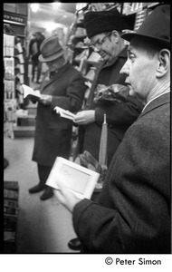 Thumbnail of Men looking at magazines at a Cambridge newsstand