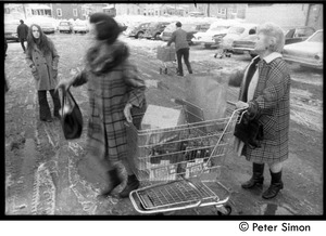 Thumbnail of Women in a parking lot with shopping carts
