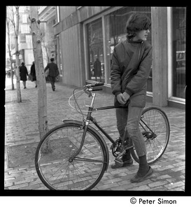 Thumbnail of Woman on a bicycle, Cambridge, Mass.