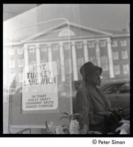 Thumbnail of Restaurant window with sign for Hot turkey sandwich and reflection, Cambridge, Mass.