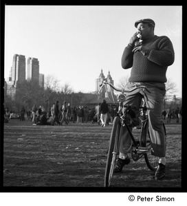 Thumbnail of Man on a bicycle at the Be-In, Central Park, New York City