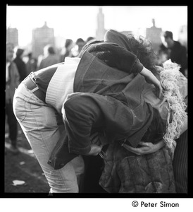 Thumbnail of Couple in a gymnastic embrace at the Be-In, Central Park, New York City