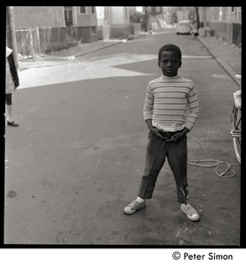 Thumbnail of African American boy standing in the street