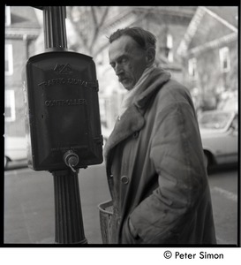 Thumbnail of Middle-aged man by a traffic signal controller box