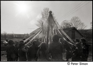 Thumbnail of Revelers dancing around the Maypole, Packer Corners commune