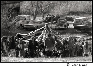 Thumbnail of Revelers carrying the maypole into the field, Packer Corners commune Includes Cathy Rogers (left in flowered skirt), Jesse Kornbluth (right of             Cathy Rogers), Citti,  George Jacobs (behind dogs), Jim Ord (right, with arm around woman)