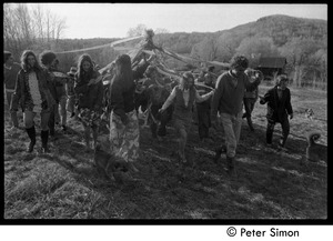 Thumbnail of Revelers carrying the maypole into the field, Packer Corners commune Includes Cathy Rogers (front if flowered skirt), Citti, George Jacobs (front             right, in sweater)