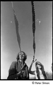 Thumbnail of Revelers at the Maypole, Packer Corners commune: close-up of revelers holding streamers Includes Lacey Mason (right)