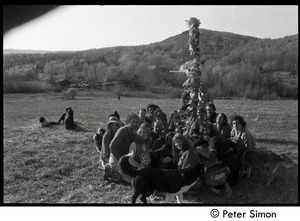 Thumbnail of Revelers seated beneath the Maypole, Packer Corners commune Includes: George Jacobs, Jim Ord, Don McLean and wife Phoebe, Citti, Brian             Kelly, Tom Fels, Jesse Kornbluth, Steve Sayer, Michael Gies, Sam Lovejoy