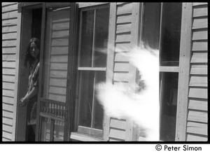 Thumbnail of May Day at Packer Corners commune: Dale Evans in a doorway and bonfire double exposure