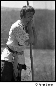 Thumbnail of May Day at Packer Corners commune: Fritz Hewitt with painted face, leaning on a staff