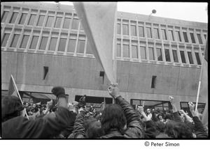 Thumbnail of MIT war research demonstration: demonstrators raising fists in front of the Hermann Building
