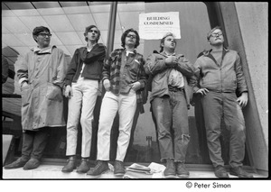 Thumbnail of MIT war research demonstration: demonstrators standing by a window outside a building