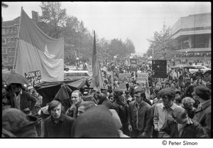 Thumbnail of MIT war research demonstration: demonstrators marching with signs and an NLF flag