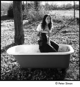 Thumbnail of Jenny Rose seated in a tub outdoors with dog, Tree Frog Farm Commune