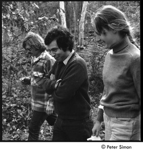 Thumbnail of Laurie Dodge, Richard Wizansky, and unidentified woman walking down a dirt road,             Tree Frog Farm Commune