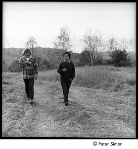 Thumbnail of Richard Wizansky (right) and Laurie Dodge, walking down a dirt road, Tree Frpg             Farm Commune