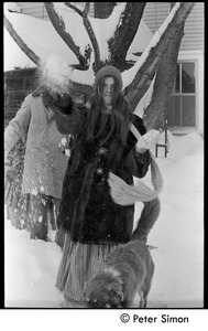 Thumbnail of Catherine Blinder in heavy winter coat throwing a snowball, Tree Frog Farm commune