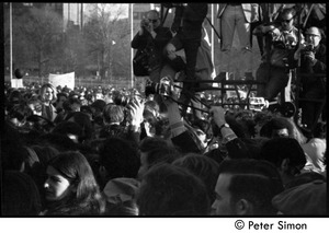Thumbnail of Press photographers climbing scaffolding above crowd of protesters Moratorium to End the War in Vietnam protest on Boston Common