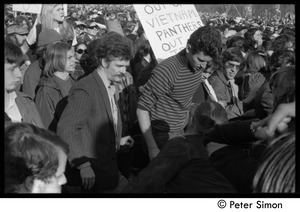 Thumbnail of Protesters in the crowd, with sign reading '[US] out of Vietnam, Panthers out...' Moratorium to End the War in Vietnam protest on Boston Common