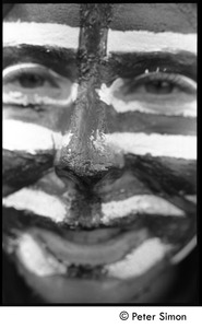 Thumbnail of Man with face painted as an American flag Moratorium to End the War in Vietnam protest on Boston Common