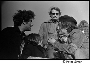 Thumbnail of Abbie Hoffman (left) talking with other protesters Moratorium to End the War in Vietnam protest on Boston Common