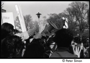 Thumbnail of Bullhorn rising above the crowd of protesters Moratorium to End the War in Vietnam protest on Boston Common