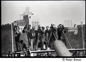 Thumbnail of Press covering the protest from atop a platform Moratorium to End the War in Vietnam protest on Boston Common