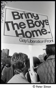 Thumbnail of View of a man holding a sign reading 'Bring the boys home -- Gay Liberation             Front' Moratorium to End the War in Vietnam protest on Boston Common
