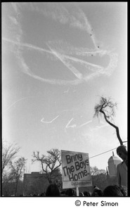 Thumbnail of View of a skywriting peace symbol dissolving above a sing reading 'Bring the boys home -- Gay Liberation             Front' Moratorium to End the War in Vietnam protest on Boston Common