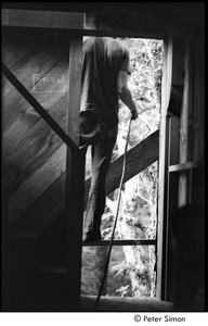 Thumbnail of James Taylor's house: Taylor standing in window of his under construction house