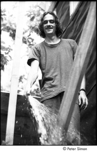 Thumbnail of James Taylor's house: Taylor spraying water out of a hose