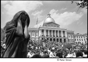 Thumbnail of Kent State Shooting Demonstration at the Boston State House: Lacey Mason holding her head in front of State House and gathered demonstrators